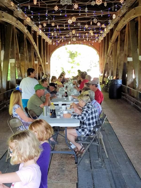 People eating breakfast on the Covered Bridge