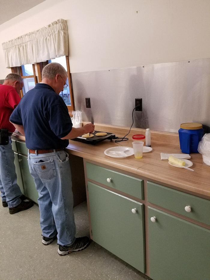 Kiwanis Members making Pancakes