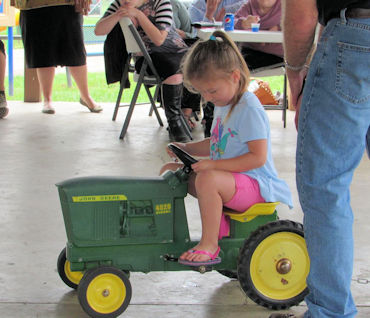 Photo of a little girl on a tractor