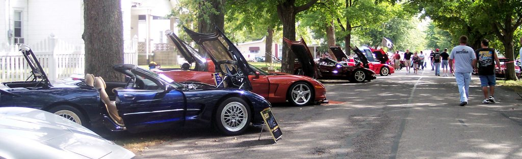 Photo of car show - cars lined up in street